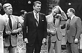 G-7 leaders prepare to pose for a group photo at the Chateau Montebello in Montebello, Quebec, Canada on July 20, 1981. From left to right: Chancellor Helmut Schmidt of West Germany, United States President Ronald Reagan, and Prime Minister Pierre Elliott Trudeau of Canada.  Inclement weather forced the photo session to be moved indoors.<br />