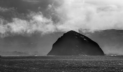 Moro Rock stands out amongst the storm clouds at Moro Bay, California