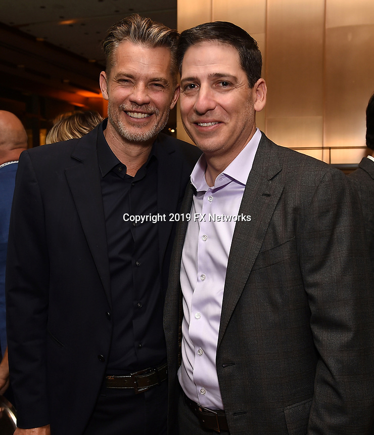LOS ANGELES - SEPTEMBER 21: (L-R) Timothy Olyphant, and Eric Schrier, President, FX Entertainment attend the FX Networks & Vanity Fair Pre-Emmy Party at Craft LA on September 21, 2019 in Los Angeles, California. (Photo by Frank Micelotta/FX/PictureGroup)