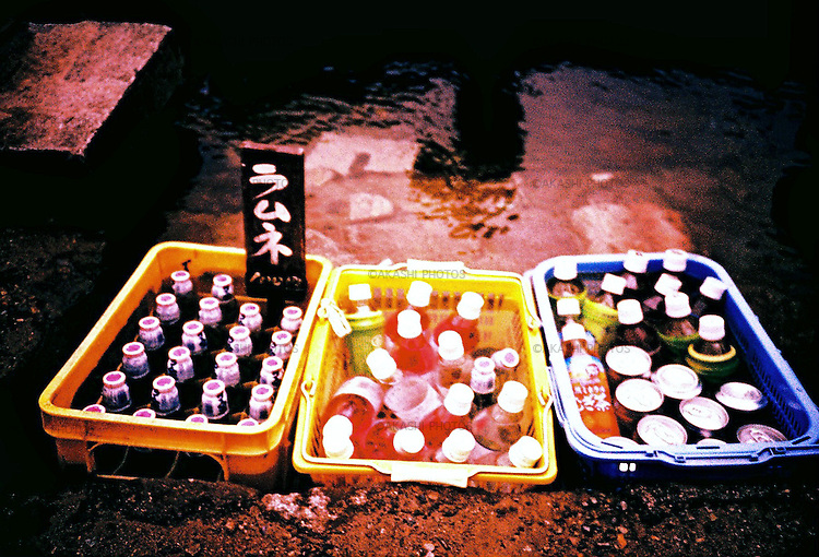 Ramune and other soft drinks are kept in the cold running water in Ouchi-Juku village in Fukushima.