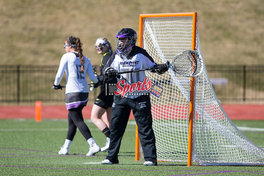 Julia Burns (20) of the High Point Panthers defends her goal during first half action against the Oregon Ducks at Vert Track, Soccer & Lacrosse Stadium on February 15, 2015 in High Point, North Carolina.  The Ducks defeated the Panthers 9-8.   (Brian Westerholt/Sports On Film)