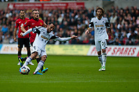 Saturday 17 August 2013<br /> <br /> Pictured: Leon Britton of Swansea<br /> <br /> Re: Barclays Premier League Swansea City v Manchester United at the Liberty Stadium, Swansea, Wales