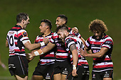 Nigle Ah Wong is mobbed by team mates after scoring just before halftime. Mitre 10 Cup game between Counties Manukau Steelers and Tasman Mako's, played at ECOLight Stadium Pukekohe on Saturday October 14th 2017. Counties Manukau won the game 52 - 30 after trailing 22 - 19 at halftime. <br /> Photo by Richard Spranger.