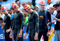 11 JUL 2009 - KITZBUHEL, AUT - Alistair Brownlee (right) watches as Brad Kahlefeldt and Javier Gomez prepare for the ITU World Championship Series Mens Triathlon (PHOTO (C) NIGEL FARROW)