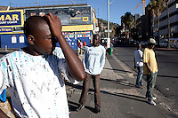 CAPE TOWN, SOUTH AFRICA - MARCH 20: Unidentified unemployed black men waits in the city center for day jobs on March 20, 2012 in Cape Town, South Africa. Some find work once or twice a week and the pay could be around US$ 15 per day. (Photo by Per-Anders Pettersson)