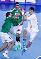 Algeria's Abdelhafid Hadjaidji (l) and Saci Boultif (c) and Croatia's Damir Bicanic during 23rd Men's Handball World Championship preliminary round match.January 14,2013. (ALTERPHOTOS/Acero) 7NortePhoto