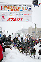 John Baker leaves the 2011 Iditarod ceremonial start line in downtown Anchorage, during the 2012 Iditarod..Jim R. Kohl/Iditarodphotos.com