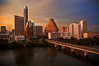 Shot from the roof at the Hyatt Hotel, this panoramic Austin skyline image features a beautiful sunset and downtown Austin at Dusk as Bat Watchers gather on the Congress Avenue Bridge over Lady Bird Lake in downtown Austin, Texas.
