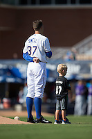 Durham Bulls starting pitcher Blake Snell (37) stands next to a youth baseball player during the National Anthem at Durham Bulls Athletic Park on August 9, 2015 in Durham, North Carolina.  The Bulls defeated the Bats 9-0.  (Brian Westerholt/Four Seam Images)