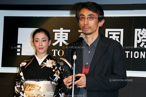 """(L to R) Rie Miyazawa, Daihachi Yoshida, October 31 2014, Tokyo, Japan : (L to R) Actress Rie Miyazawa and director Daihachi Yoshida of """"Pale Moon"""" receive the Audience Award and the Award for Best Actress during the Closing Ceremony of The 27th Tokyo International Film Festival at TOHO CINEMAS in Roppongi Hills on October 31, 2014, Tokyo, Japan. The 27th Tokyo International Film Festival is one of the biggest film festivals in Asia and runs from October 23 to 31. (Photo by Rodrigo Reyes Marin/AFLO)"""