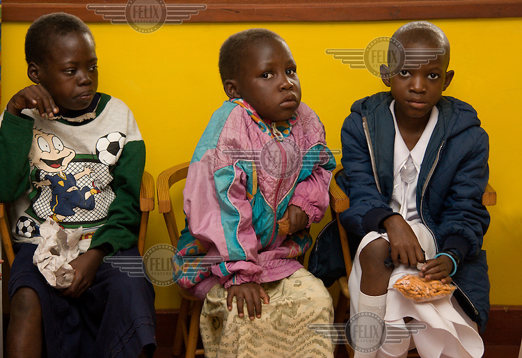 Children with HIV wait at Jajja's Home Daycentre in Mildmay hospital. Mildmay is an international HIV/AIDS charity, specialising in care, training and service development within this field.