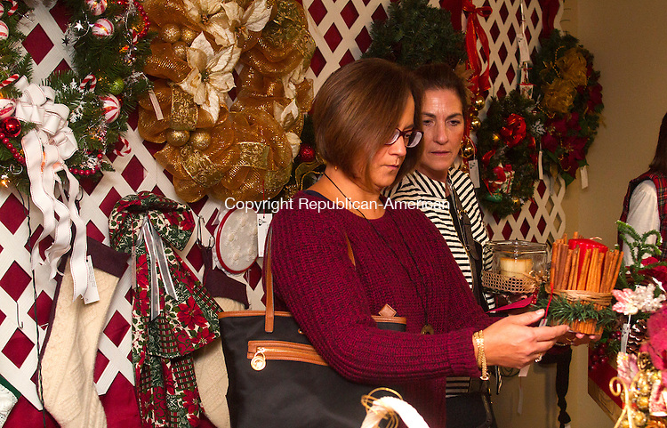 SOUTHBURY, CT - 21 NOVEMBER 2015 -112115JW07.jpg -- Jackie Metivier of Watertown and Elise Wingen of Southbury look over some ornamental cadles for sale during the United Church of Christ 49th Annual Holiday Fair Saturday afternoon.  Jonathan Wilcox Republican-American