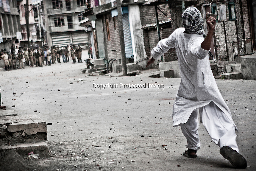 A Kashmiri Muslim protester throws stones during a street protest against the Indian rule in downtown Srinagar. Stone pelting held by Kashmiri youth has become a sign of resistance against the Indian occupation and is inspired by the Palestinian intifadas. Srinagar, Indian administrated Kashmir.