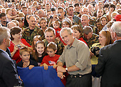 Martinsburg, WVa - July 4, 2007 -- United States President George W. Bush poses with guest for photos after speaking to the West Virginia Air National Guard 167th Airlift Wing and other guests on base in Martinsburg, West Virginia, on July 4, 2007.<br /> Credit: Roger L. Wollenberg - Pool via CNP