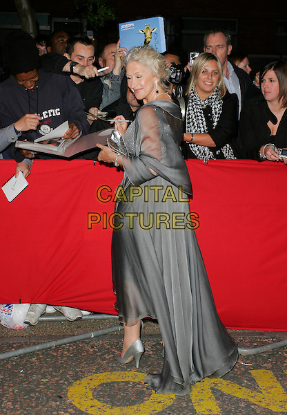 DAME HELEN MIRREN.Arrivals - Greatest Britons 2007 Awards Show, .The London Studios, London, Engand, May 21st 2007. .full length  grey silver floaty dress back behind signing autographs fans looking over shoulder.CAP/AH.©Adam Houghton/Capital Pictures.
