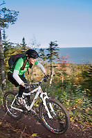 Riding The Flow trail with views of Lake Superior while mountain biking in Copper Harbor Michigan Michigan's Upper Peninsula.