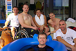 Federal Minister (Disabilities and Children's services) Mr Bill Shorten takes a tour of the facilities in the Beijing Paralympic Village, and takes up a challenge from the Australian Men's Wheelchair basketball team to take an ice bath with them.15 September, 2008.