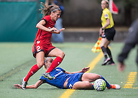 Seattle, WA - Saturday Aug. 27, 2016: Katherine Reynolds, Beverly Yanez during a regular season National Women's Soccer League (NWSL) match between the Seattle Reign FC and the Portland Thorns FC at Memorial Stadium.