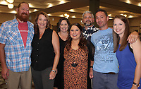NWA Democrat-Gazette/CARIN SCHOPPMEYER Andy and Alison Miller (from left), Amanda Barker, Ferrin Webb, Neil Barker and Nate and Ashley Mille gather at the Beach Bingo Bash.