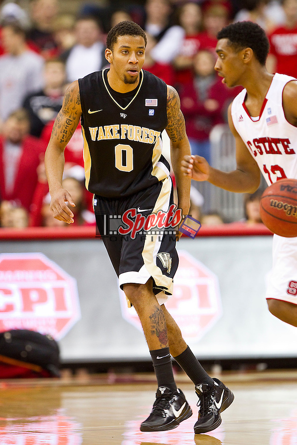 J.T. Terrell #0 of the Wake Forest Demon Deacons guards Rya Harrow #12 of the North Carolina State Wolfpack at the RBC Center on January 8, 2011 in Raleigh, North Carolina.  The Wolfpack defeated the Demon Deacons 90-69.  Photo by Brian Westerholt / Sports On Film