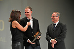 Current Champion Christopher Froome (GBR) is awarded the Velo d&quot;Or Mondial prize presented by 5 time Tour Champion Bernard Hinault (FRA) at the Tour de France 2018 route presentation held at Palais de Congress, Paris, France. 17th October 2017.<br /> Picture: ASO/Bruno Bade | Cyclefile<br /> <br /> <br /> All photos usage must carry mandatory copyright credit (&copy; Cyclefile | ASO/Bruno Bade)