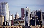 Porto Alegre, Brazil. City skyline showing modern high rise office buildings with domed church behind.