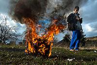 A young boy burns the used electric wires to recycle copper (and sell it afterwards) in the Gipsy ghetto of Chanov on outskirts of Most, Czech Republic, 22 March 2008.