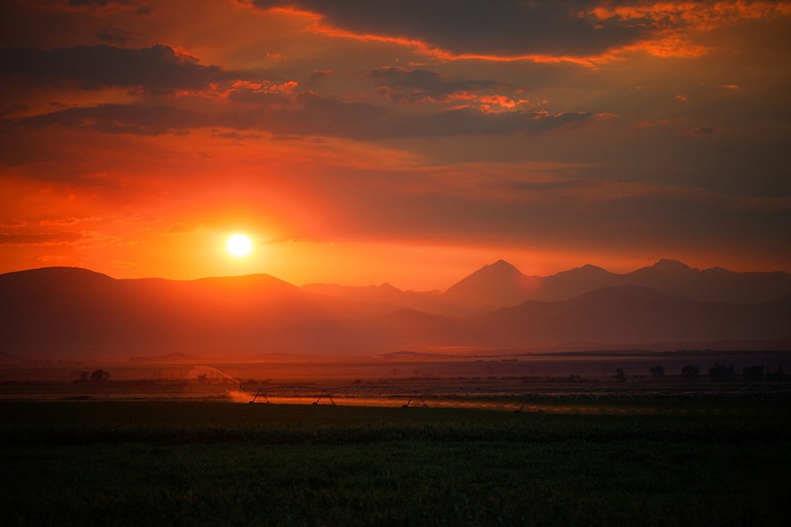 The sun sets over the Pioneer Mountains and the Beaverhead River near Dillon, Montana.