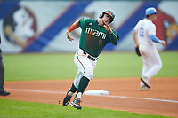 Carl Chester (9) of the Miami Hurricanes hustles towards home plate against the North Carolina Tar Heels in the second semifinal of the 2017 ACC Baseball Championship at Louisville Slugger Field on May 27, 2017 in Louisville, Kentucky. The Tar Heels defeated the Hurricanes 12-4. (Brian Westerholt/Four Seam Images)
