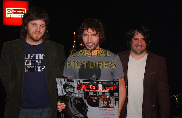 James Blunt (middle) and his band with a gold record for the selling of 35.000 copies in The Netherlands from the album All The Lost Souls.