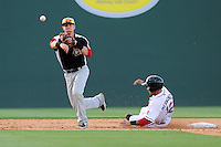Second baseman Ryan Rua (2) of the Hickory Crawdads steps aside as a sliding Jayson hernandez (12) of the Greenville Drive is out in a double play in a game on Friday, June 7, 2013, at Fluor Field at the West End in Greenville, South Carolina. Greenville won the resumption of this May 22 suspended game, 17-8. (Tom Priddy/Four Seam Images)