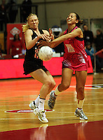 World wing attack Frances Solia intercepts a pass to Laura Langman during the International  Netball Series match between the NZ Silver Ferns and World 7 at TSB Bank Arena, Wellington, New Zealand on Monday, 24 August 2009. Photo: Dave Lintott / lintottphoto.co.nz