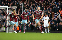 Sunday 07 December 2014<br /> Pictured: Andy Carroll of West Ham (R) is celebratingf his second goal<br /> Re: Premier League West Ham United v Swansea City FC at Boleyn Ground, London, UK.