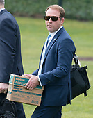 White House Deputy Director of Presidential Advance Jordan Karem carries a box of papers to Marine One as he prepares to accompany United States President Donald J. Trump as he departs the White House in Washington, DC for a day trip to Cleveland, Ohio and then on to Mar-a-Lago for the Easter weekend on Thursday, March 29, 2018.<br /> Credit: Ron Sachs / CNP