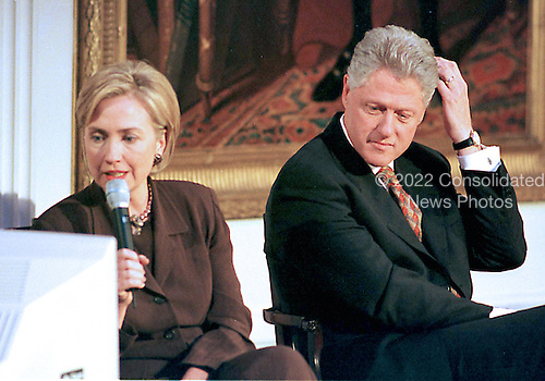 """First lady Hillary Rodham reads a viewer's question during the live broadcast of the """"Millennium Evening Lecture Series"""" from The East Room of The White House in Washington, DC as United States President Bill Clinton looks on,18 September, 1998.<br /> Credit: Ron Sachs / CNP"""
