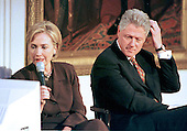 "First lady Hillary Rodham reads a viewer's question during the live broadcast of the ""Millennium Evening Lecture Series"" from The East Room of The White House in Washington, DC as United States President Bill Clinton looks on,18 September, 1998.<br /> Credit: Ron Sachs / CNP"