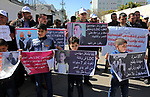 Palestinians take part in a protest against a U.S. decision to cut aid, in front of the headquarters United Nations Relief and Works Agency (UNRWA) in Gaza city on February 28, 2018. Photo by Ashraf Amra