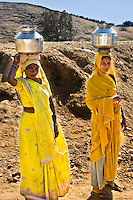 The saris of these women contrast starkly with the parched Rajasthani landscape. (Photo by Matt Considine - Images of Asia Collection)