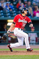 Corey Seager #12 of the Great Lakes Loons follows through on an RBI single against the Wisconsin Timber Rattlers at the Dow Diamond on May 4, 2013 in Midland, Michigan.  The Timber Rattlers defeated the Loons 6-4.  (Brian Westerholt/Four Seam Images)