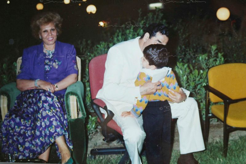 Baghdad, Iraq, Saddam's family pictures, date unknown..Saddam, center, with his wife Sajida, left and one of his grand sons.