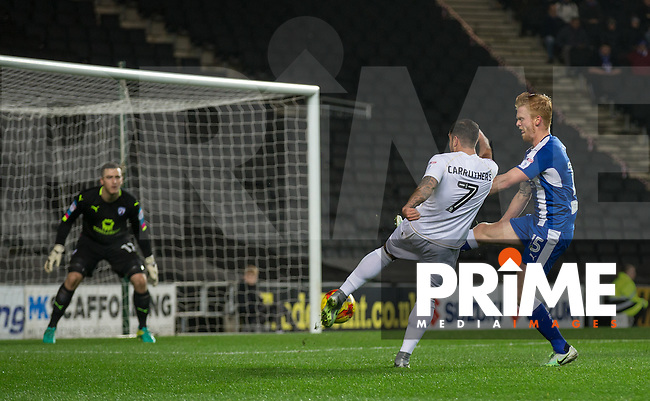 Samir Carruthers of Milton Keynes Dons shoots at goal under pressure from Liam O'Neil of Chesterfield during the Sky Bet League 1 match between MK Dons and Chesterfield at stadium:mk, Milton Keynes, England on 22 November 2016. Photo by Andy Rowland.