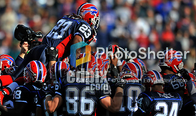 2 November 2008:  Buffalo Bills' running back Marshawn Lynch (23) jumps over the shoulders of teammates prior to a game against the New York Jets at Ralph Wilson Stadium in Orchard Park, NY. The Jets defeated the Bills 26-17 improving their record to 5 and 3 for the season...Mandatory Photo Credit: Ed Wolfstein Photo