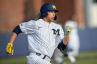 Michigan Wolverines outfielder Jordan Brewer (22) runs to first base during the NCAA baseball game against the Eastern Michigan Eagles on May 8, 2019 at Ray Fisher Stadium in Ann Arbor, Michigan. Michigan defeated Eastern Michigan 10-1. (Andrew Woolley/Four Seam Images)