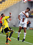 Perth Glory's Matthew Davies, right, heads the ball as Phoenix's Kenny Cunningham, left, looks on in the A-League football match at Westpac Stadium, Wellington, New Zealand, Sunday, March 09, 2014. Credit: Dean Pemberton