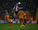 Chris Basham of Sheffield Utd climbs high to head the ball during the Championship match at the Bramall Lane Stadium, Sheffield. Picture date 27th September 2017. Picture credit should read: Simon Bellis/Sportimage