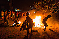 02 January, 2014 - Phnom Penh. Street fires burn as protestors block streets following a violent government crackdown on garment workers demanding a wage increase. © Nicolas Axelrod / Ruom