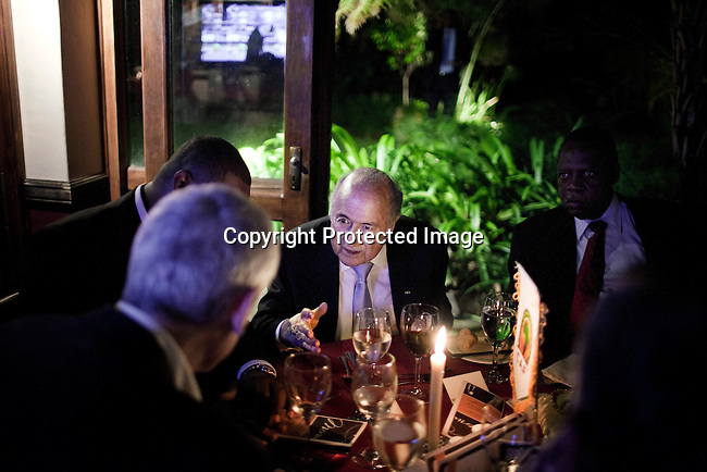 JOHANNESBURG, SOUTH AFRICA - FEBRUARY 9: FIFA president Sepp Blatter chats to soccer officials during a dinner in his honor on February 9, 2013 Sun international hotel in Sandton, Johannesburg, South Africa. Mr. Blatter visited South Africa to watch the final game of the CAP, Africa's Cup of Nations between Nigeria and Burkina Faso. (Photo by Per-Anders Pettersson)
