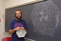New York, NY, USA - June 24-25, 2017: OrigamiUSA 2017 Convention at St. John's University, Queens, New York, USA. Alessandro Beber, Italy, teaches a class how to fold his complex 1-Cube Tessellation.