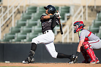 Joel Booker (23) of the Kannapolis Intimidators follows through on his swing against the Hagerstown Suns at Kannapolis Intimidators Stadium on June 15, 2017 in Kannapolis, North Carolina.  The Intimidators walked-off the Suns 5-4 in game one of a double-header.  (Brian Westerholt/Four Seam Images)