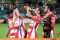 20130809 Copyright onEdition 2013 ©<br /> Free for editorial use image, please credit: onEdition.<br /> <br /> Gloucester Rugby 7s players celebrate winning the finals of the J.P. Morgan Asset Management Premiership Rugby 7s Series.<br /> <br /> The J.P. Morgan Asset Management Premiership Rugby 7s Series kicked off for the fourth season on Thursday 1st August with Pool A at Kingsholm, Gloucester with Pool B being played at Franklin's Gardens, Northampton on Friday 2nd August, Pool C at Allianz Park, Saracens home ground, on Saturday 3rd August and the Final being played at The Recreation Ground, Bath on Friday 9th August. The innovative tournament, which involves all 12 Premiership Rugby clubs, offers a fantastic platform for some of the country's finest young athletes to be exposed to the excitement, pressures and skills required to compete at an elite level.<br /> <br /> The 12 Premiership Rugby clubs are divided into three groups for the tournament, with the winner and runner up of each regional event going through to the Final. There are six games each evening, with each match consisting of two 7 minute halves with a 2 minute break at half time.<br /> <br /> For additional images please go to: http://www.w-w-i.com/jp_morgan_premiership_sevens/<br /> <br /> For press contacts contact: Beth Begg at brandRapport on D: +44 (0)20 7932 5813 M: +44 (0)7900 88231 E: BBegg@brand-rapport.com<br /> <br /> If you require a higher resolution image or you have any other onEdition photographic enquiries, please contact onEdition on 0845 900 2 900 or email info@onEdition.com<br /> This image is copyright the onEdition 2013©.<br /> <br /> This image has been supplied by onEdition and must be credited onEdition. The author is asserting his full Moral rights in relation to the publication of this image. Rights for onward transmission of any image or file is not granted or implied. Changing or deleting Copyright information is illegal as specified in the Copyright, Design and Patents Act 1988. If you are in any way unsure of your right to publish this image please contact